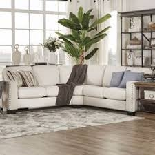 White Fabric Sectional Sofa by Grey Sofa With Nailheads Buy Steve Silver Torrey Sectional In