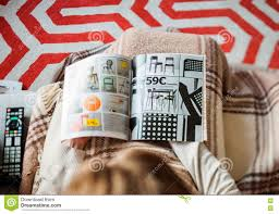 buying from ikea catalogue woman editorial stock photo image