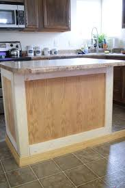 how to add trim to bottom of kitchen cabinets add molding to a builder grade kitchen island an easy how