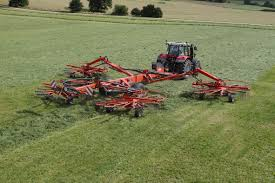 kuhn supersizes its ranges of grass rakes farm machinery