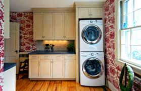 modern small laundry room stackable washer dryer with wooden