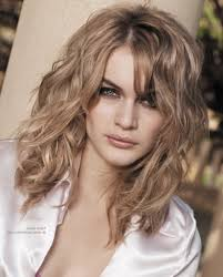 pictures on best haircuts for curly hair and round face