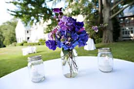jar flower centerpieces jar wedding centerpieces purple blue flowers