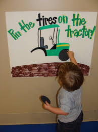 pin the tire on the tractor game for a farm themed birthday love