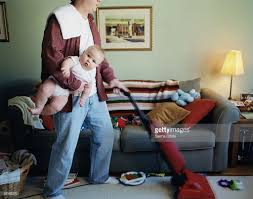 Vacuuming Father Holding Baby And Vacuuming Stock Photo Getty Images