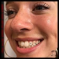 diamond stud on tooth tooth jewelry arts