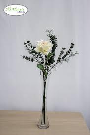 realistic cream rose with gypsophilia in glass vase arrangement