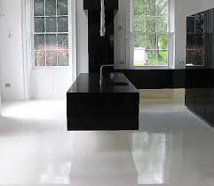 Kitchen Floorings Ultra Modern Gloss Black Floating Cantilevered Kitchen With Pure