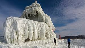 incredible frozen lighthouses on lake michigan photos the