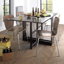 wooden parquet floor with sleek chairs and modern table set for