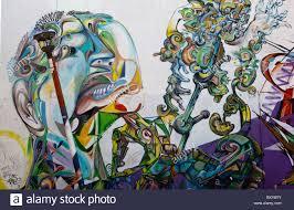 abstract wall mural depicting a mans head along a street in the abstract wall mural depicting a mans head along a street in the spanish colonial city of santiago de queretaro mexico