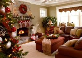 living room christmas decor brick fireplace red gold painting