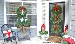 front porch christmas decorations 14 front porch christmas decor ideas that will make the neighbors