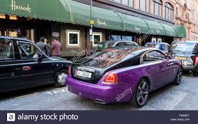 london uk 5 april 2016 a rolls royce wraith passes harrods