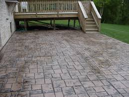 Cement Patio Cost Per Square Foot by Stamped Concrete Patio Coming Off Of A Simple Deck Just Needs