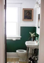 easy bathroom makeover with forest green and white walls and wall