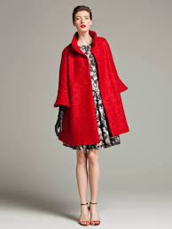 red cape coat keeping warm at work professional woman