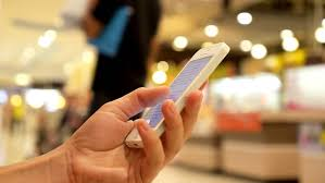 black friday samsung phone sales man hands pulls out sticker with red sale inscription from empty
