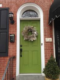brick black shutters and green door still like this color combo