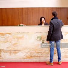 Standing Reception Desk by Man Standing At Reception Desk In Hotel Lobby Stock Photo Getty