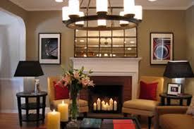 beige fireplace mantle heat shield regtangular mirror wall collage