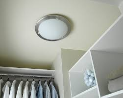 simple dressing room with round ceiling closet light design white