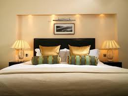 Home Interior Design Companies by Charming Pillows Interior Design With Gold Color And Desk Lamps On