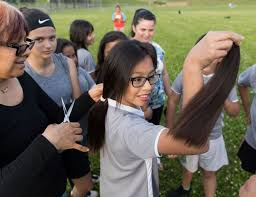 girls on omaha youth soccer team cut their hair in solidarity with