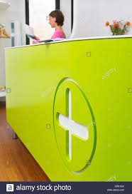Medical Reception Desks by Medical Reception Desk With Woman Working In Background Stock