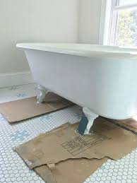 Refinish Your Cast Iron Tub This Old House How To Refinish A Nasty Old Clawfoot Tub
