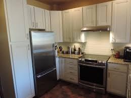 antique white kitchen cabinet refacing cabinet refacing done in maple and antique white modern