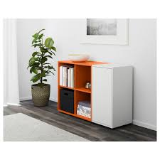 how to decorate a shelf in living room eket storage combination with feet white orange ikea