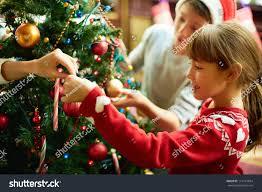 portrait happy decorating christmas tree stock photo
