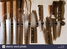 magnetic strips for kitchen knives many kitchen knives on magnetic stock photo royalty free