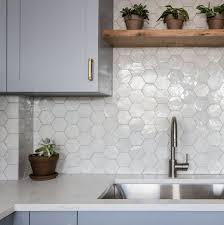 white kitchen cabinets with hexagon backsplash weathered white zellige 3 5 x4 x3 8 hex kitchen