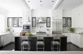 white kitchen with black island white kitchen with black island and yellow ikat counter stools