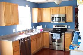blue kitchen walls with brown cabinets pin on home