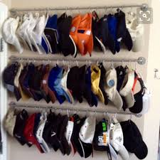 ball cap storage with towel bars and curtain clips storage