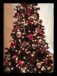 lovely black christmas tree with red decorations charming white