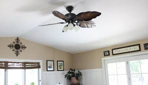 leaves ceiling fan with white glass shaded lights as well as large