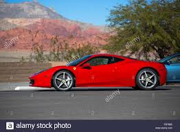 Ferrari 458 Coupe - ferrari 458 italia in rosso corsa red against the mountains of red