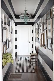 grey white paint narrow bedroom hallway with gloss wooden flooring