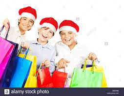 happy santa boys with gifts kids carrying colorful shopping bags
