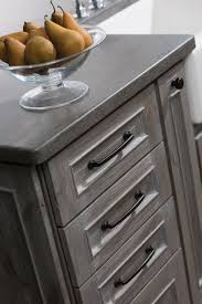 best images about month colors the year pinterest dramatic new finishes from dura supreme cabinetry weathered finish resembles reclaimed wood kitchen