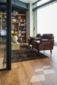 honey coloured oak floor custom karaka residence designer
