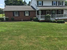 mowing landscaping patios walkways yard clean up grading