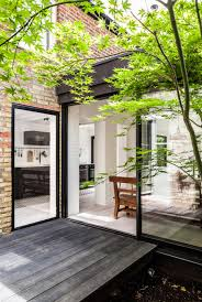 what is a courtyard kirkwood mccarthy adds zinc clad garden wing to north london house