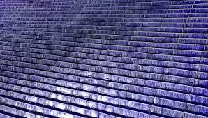 water flows down the blue ceramic steps in indoor garden stock