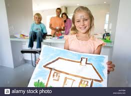 Painting Of House by Holding Painting Of House Smiling Portrait Family In Stock