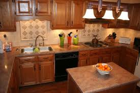 tile backsplash granite countertop u0026 oak colored cupboards re